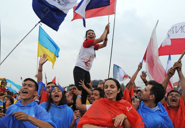 Faithful participating in the World Youth Days greet Pope Francis in Krakow, Poland. (AP Photo/Alik Keplicz)