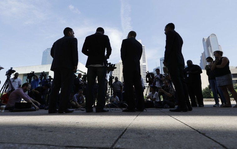 Rev. Jeff Hood and other organizers of Thursday's protest hold a news conference, Friday, July 8, 2016, in Dallas. Five police officers are dead and several injured following a shooting during what began as a peaceful protest in the city the night before. (AP Photo/Eric Gay)