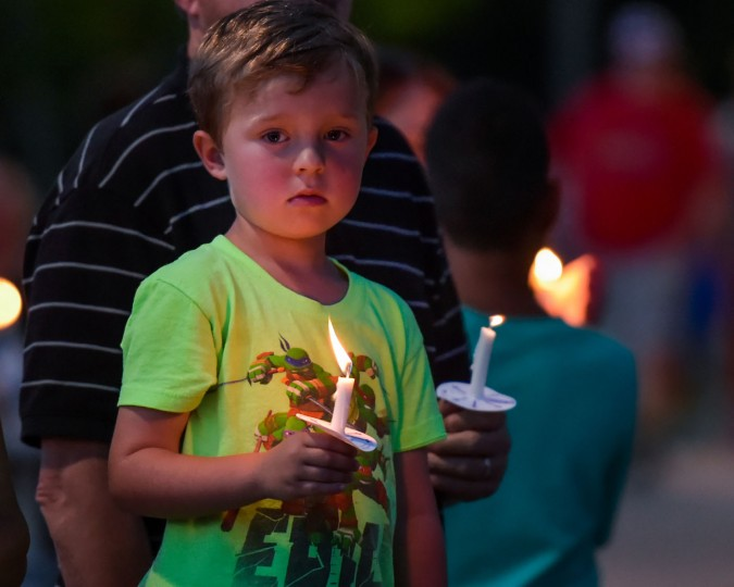 Landon Babin attends a candlelight vigil for the fallen Baton Rouge police officers at the Healing Place Church in Baton Rouge, La., Monday, July 18, 2016. Multiple police officers were killed and wounded Sunday morning in a shooting near a gas station in Baton Rouge. (Scott Clause/The Daily Advertiser via AP)