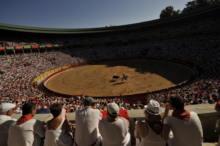 Spanish mounted bullfighter Pablo Hermoso de Mendoza performs during a horseback bullfight at San Fermin Fiestas, in Pamplona, northern Spain, Wednesday, July 6, 2016. People from around the world kick off the festival with a messy party in the Pamplona town square, one day before the first of eight days of the running of the bulls. (AP Photo/Alvaro Barrientos)