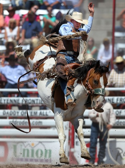 Clay Elliott of Nanton, Alberta, competes in the saddle bronc event during the fifth day of the 120th annual Cheyenne Frontier Days Rodeo Wednesday afternoon, July 27, 2016, at Frontier Park Arena in Cheyenne, Wyo. (Blaine McCartney/Wyoming Tribune Eagle via AP)