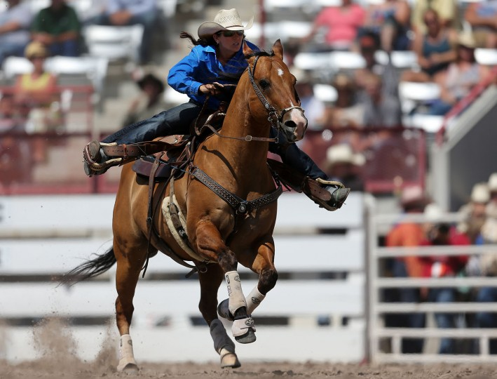 Heather Ratterree of Peyton, Colo., races toward the third barrel in the barrel racing event during the fifth performance of the 120th annual Cheyenne Frontier Days Rodeo Wednesday afternoon, July 27, 2016, at Frontier Park Arena in Cheyenne, Wyo. (Blaine McCartney/Wyoming Tribune Eagle via AP)