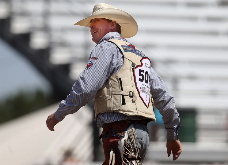 Chet Johnson of Douglas, Wyo., looks back at the scoreboard after his ride in the saddle bronc event during the fifth day of the 120th annual Cheyenne Frontier Days Rodeo Wednesday afternoon, July 27, 2016, at Frontier Park Arena in Cheyenne, Wyo. (Blaine McCartney/Wyoming Tribune Eagle via AP)