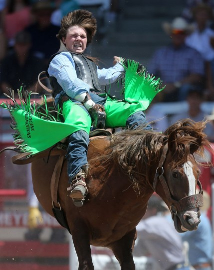 Connor Hamilton, of Weatherford, Okla., competes in the first section of the saddle bronc event during the first day of the Cheyenne Frontier Days Rodeo, Saturday, July 23, 2016, at Frontier Park Arena in Cheyenne, Wyo. (Blaine McCartney/Wyoming Tribune Eagle via AP)