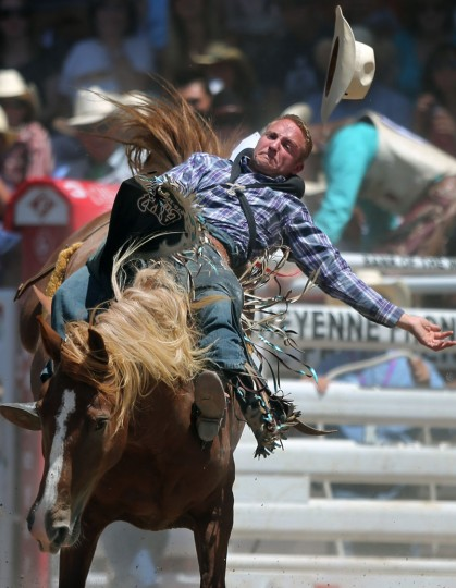 Craig Wisehart, of Kersey, Colo., competes in the bareback event during the first day of the Cheyenne Frontier Days Rodeo, Saturday, July 23, 2016, at Frontier Park Arena in Cheyenne, Wyo. (Blaine McCartney/Wyoming Tribune Eagle via AP)