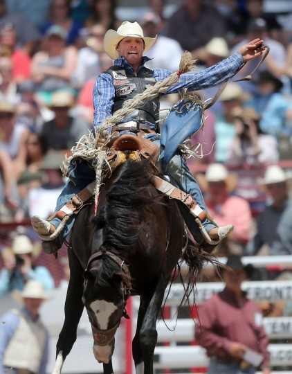 Cole Elshere, of Faith, S.D., competes in the saddle bronc event during the first day of the Cheyenne Frontier Days Rodeo, Saturday, July 23, 2016, at Frontier Park Arena in Cheyenne, Wyo. (Blaine McCartney/Wyoming Tribune Eagle via AP)