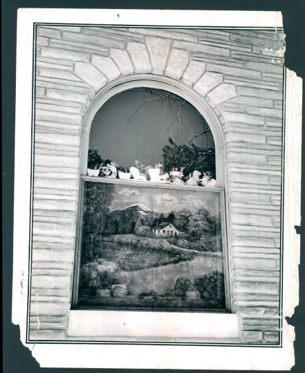The hand-painted screen, a tradition in some parts of the city, serves as a decorative protection against insects. (1963)