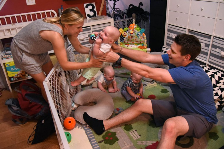 Thomas Hewitt Jr. hands off Finn to Kristen as quiet playtime continues for Trip and Ollie. (Amy Davis/Baltimore Sun)