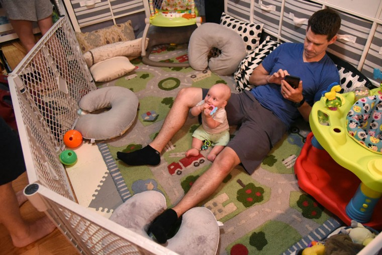 Finn is able to sit up and chew on a teething toy as he enjoys quiet time with his father, Thomas Hewitt Jr. (Amy Davis/Baltimore Sun)