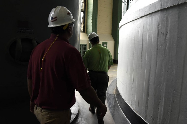 Jay Campbell, left, technical services manager, and Archie Gleason, right, general manager, walk between turbines in the turbine hall at Exelon's Conowingo Hydroelectric Plant, which has been producing electricity on the Susquehanna River since 1928. (Barbara Haddock Taylor, Baltimore Sun)