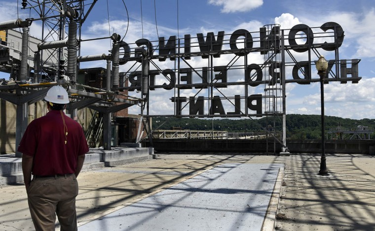Jay Campbell, technical services manager, stands on the roof substation at the Execlon Conowingo Hydroelectric Plant, which has been producing electricity on the Susquehanna River since 1928. (Barbara Haddock Taylor, Baltimore Sun)