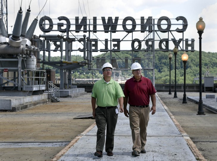 Archie Gleason, left, general manager, and Jay Campbell, right, technical services manager, walk on the roof substation at the Exelon Conowingo Hydroelectric Plant, which has been producing electricity on the Susquehanna River since 1928. (Barbara Haddock Taylor, Baltimore Sun)