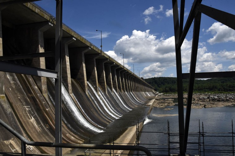 Crest gates, viewed through a stairway on the roof substation, allow 16,500 cubic feet of water per second over the dam at the Exelon Conowingo Hydroelectric Plant, which has been producing electricity on the Susquehanna River since 1928. (Barbara Haddock Taylor, Baltimore Sun)