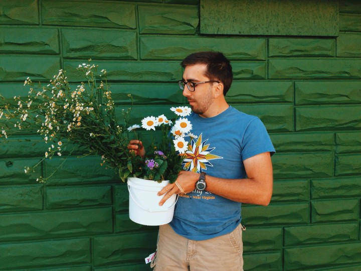 Peter has a flower farm, Petal Root Garden, in Reservoir Hill. Picking up some flowers from him at the Hampden Flowers Market.