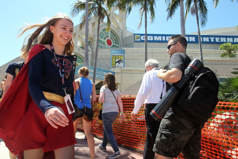Tyler Greening of Albuquerque, New Mexico, dressed as Supergirl, careens past the San Diego Convention Center where the Comic-Con International 2016 is being held in San Diego, California on July 21, 2016. (BILL WECHTER/AFP/Getty Images)