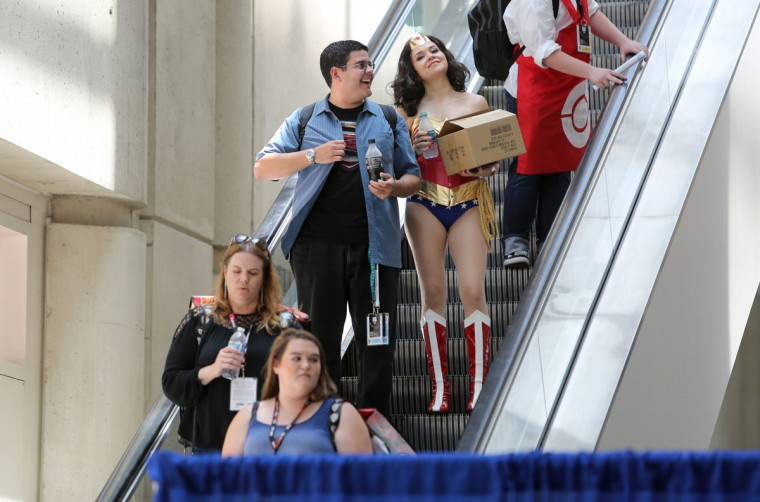 Even carrying a cardboard box Marlene Lopez of Los Angeles stands out as the character Wonder Woman during Comic-Con International 2016 in San Diego, California on July 21, 2016. (BILL WECHTER/AFP/Getty Images)