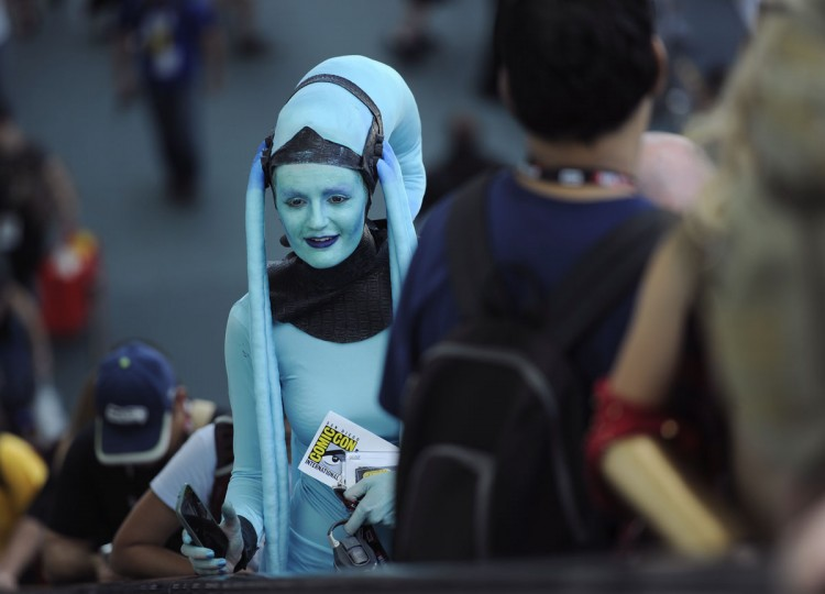 "Leah Thomas, of San Diego, dressed as Diva Plavalaguna from ""The Fifth Element,"" attends day 1 of Comic-Con International on Thursday, July 21, 2016, in San Diego. (Photo by Chris Pizzello/Invision/AP)"