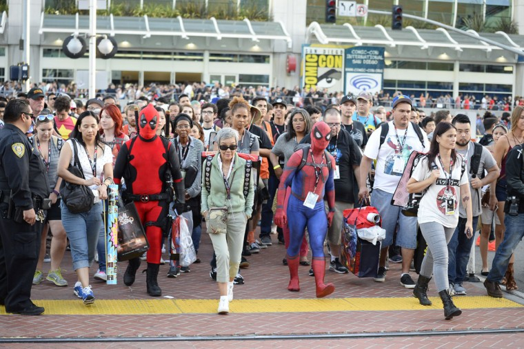 Fans leave the convention center on day one of Comic-Con International held at the San Diego Convention Center Thursday, July 21, 2016, in San Diego. (Photo by Denis Poroy/Invision/AP)