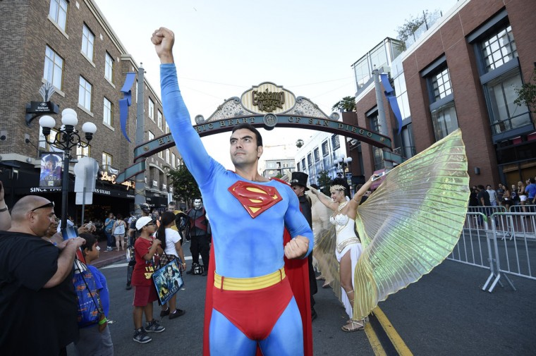 Sergio Valente, dressed as Superman, poses next to Isis Cress, dressed as the goddess Isis, outside of the convention center on day one of Comic-Con International held at the San Diego Convention Center Thursday July 21, 2016 in San Diego. (Photo by Denis Poroy/Invision/AP)