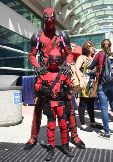 Fans dressed as Deadpool attend day 1 of Comic-Con International on Thursday, July 21, 2016, in San Diego. (Photo by Al Powers/Invision/AP)