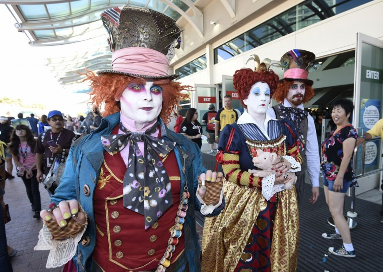 Members of the League of Hatters walk in front of the convention center on day one of Comic-Con International held at the San Diego Convention Center Thursday, July 21, 2016, in San Diego. (Photo by Denis Poroy/Invision/AP)