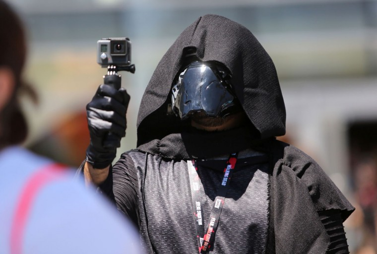 A Darth Vader-style creature documents some of the scene during Comic-Con International 2016 in San Diego, California on July 21, 2016. (BILL WECHTER/AFP/Getty Images)