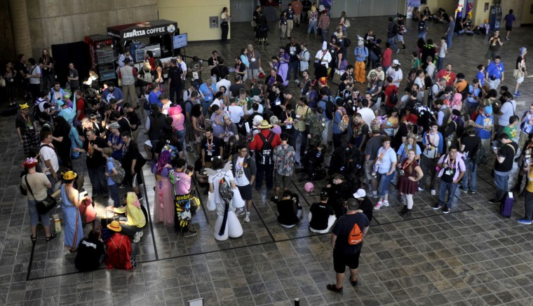 The crowd waits in line for autograph vouchers. BronyCon is the world's largest My Little Pony: Friendship is Magic convention. Held at the Baltimore Convention Center, BronyCon features panels, meet-ups, activities, and cosplay. (Caitlin Faw/Baltimore Sun staff)