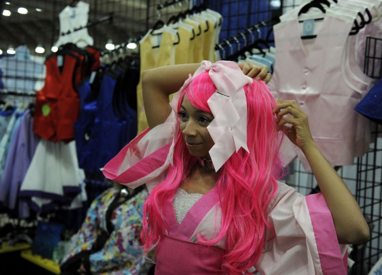 Jazzmin Jolly, wearing a Pinkie Pie outfit provided by Corsairs Boutique, fixes her hair in the Blank Canvas's Marketplace. BronyCon is the world's largest My Little Pony: Friendship is Magic convention. Held at the Baltimore Convention Center, BronyCon features panels, meet-ups, activities, and cosplay. (Caitlin Faw/Baltimore Sun staff)