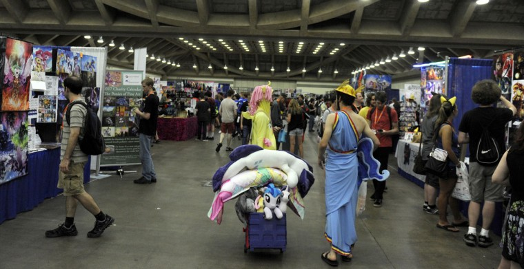 Vendors in the Blank Canvas's Marketplace offer a variety of items — plushies, taro cards, coins, sculptures, and pony art. BronyCon is the world's largest My Little Pony: Friendship is Magic convention. Held at the Baltimore Convention Center, BronyCon features panels, meet-ups, activities, and cosplay. (Caitlin Faw/Baltimore Sun staff)