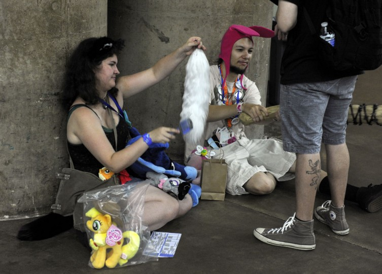 Zira Lelkand, 20, brushes a new mane she purchased at the Blank Canvas's Marketplace. BronyCon is the world's largest My Little Pony: Friendship is Magic convention. Held at the Baltimore Convention Center, BronyCon features panels, meet-ups, activities, and cosplay. (Caitlin Faw/Baltimore Sun staff)
