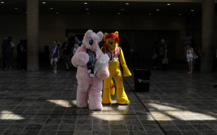Fluffle Puff and a fellow pony pass through the Baltimore Convention Center. BronyCon is the world's largest My Little Pony: Friendship is Magic convention. BronyCon features panels, meet-ups, activities, and cosplay. (Caitlin Faw/Baltimore Sun staff)