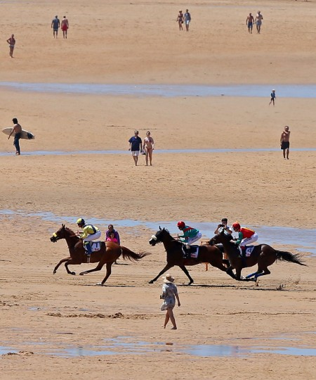 Jockeys and their mounts race along the beach during the annual beach horse race in Loredo, near the northern Spanish city of Santander, on July 24, 2016. (CESAR MANSO/AFP/Getty Images)