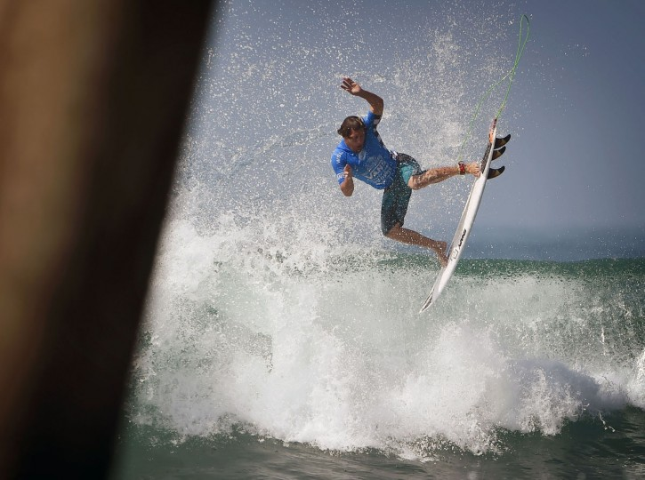 Robson Santos of Brazil gets air before winning his men's heat during the first round of the US Open of Surfing at Huntington Beach, California on July 25, 2016. (MARK RALSTON/AFP/Getty Images)
