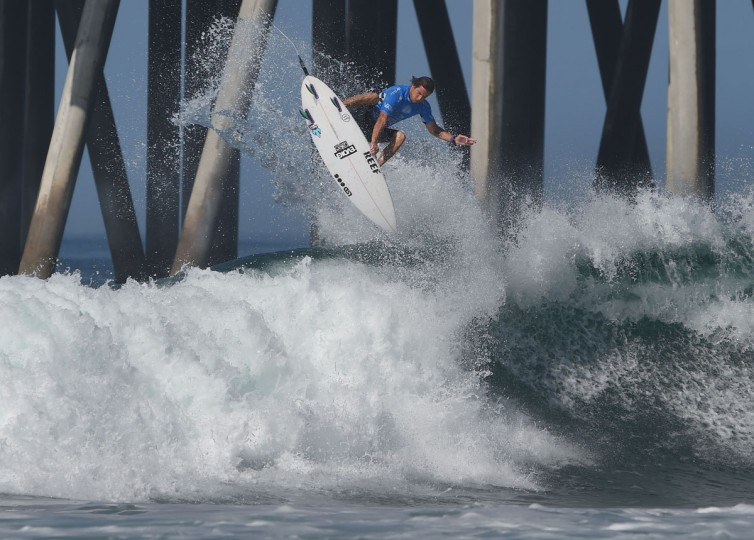 Thiago Camarao of Brazil gets air before winning his men's heat during the first round of the US Open of Surfing at Huntington Beach, California on July 25, 2016. (MARK RALSTON/AFP/Getty Images)