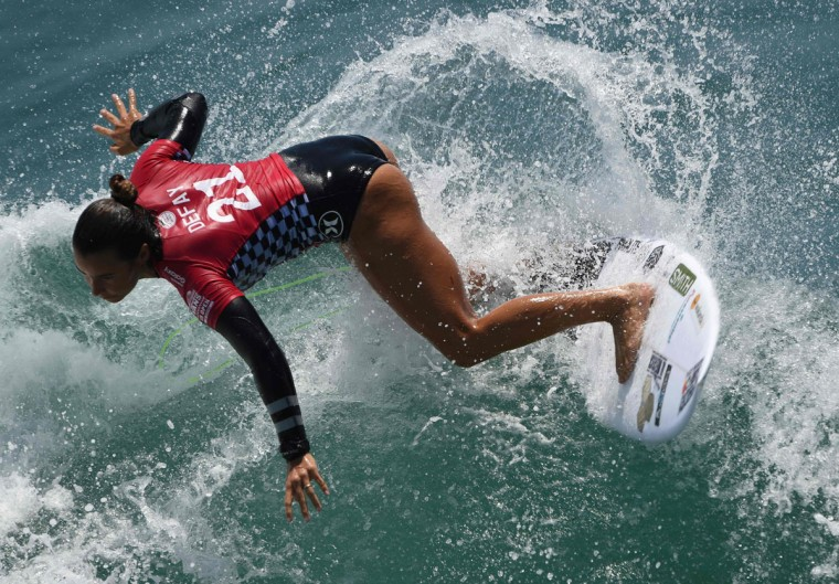 Johanne Defay of France surfs during her women's heat in the first round of the US Open of Surfing at Huntington Beach, California on July 25, 2016. (MARK RALSTON/AFP/Getty Images)