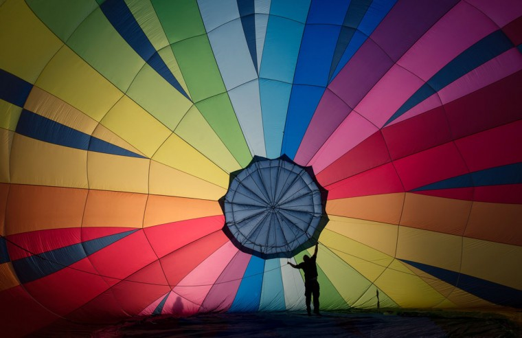 A hot air balloon is prepared to take to the skies at a preview flight to launch next week's Bristol International Balloon Fiesta on August 5, 2016 in Bristol, England. The four day event event, which will officially open next week on Thursday, is now in its 38th year and is Europe's largest annual hot air balloon event in the city that is seen as many as the home of modern ballooning. (Photo by Matt Cardy/Getty Images)