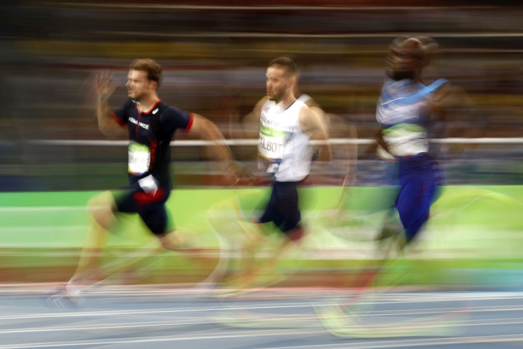 (L-R) France's Christophe Lemaitre, Britain's Daniel Talbot and USA's Lashawn Merritt compete in the Men's 200m Semifinal during the athletics event at the Rio 2016 Olympic Games at the Olympic Stadium in Rio de Janeiro on August 17, 2016. (Adrian Dennis/AFP/Getty Images)