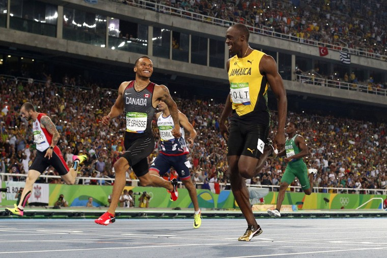 Canada's Andre De Grasse and Jamaica's Usain Bolt cross the finish line in the Men's 200m Semifinal during the athletics event at the Rio 2016 Olympic Games at the Olympic Stadium in Rio de Janeiro on August 17, 2016. (Adrian Dennis/AFP/Getty Images)