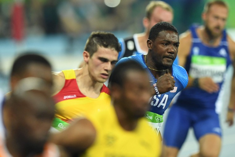 USA's Justin Gatlin (R) competes in the Men's 200m Semifinal during the athletics event at the Rio 2016 Olympic Games at the Olympic Stadium in Rio de Janeiro on August 17, 2016. (Martin Bernetti/AFP/Getty Images)