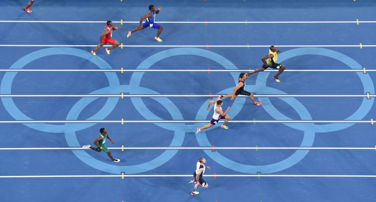(FromR) Jamaica's Usain Bolt, Canada's Andre De Grasse, Britain's Adam Gemili, Turkey's Ramil Guliyev, USA's Ameer Webb, Bahrain's Yaqoob Salem Eid Yaqooband Nigeria's Ejowvokoghene Oduduru compete in the Men's 200m Semifinal during the athletics event at the Rio 2016 Olympic Games at the Olympic Stadium in Rio de Janeiro on August 17, 2016. (Antonin Thuillier/AFP/Getty Images)