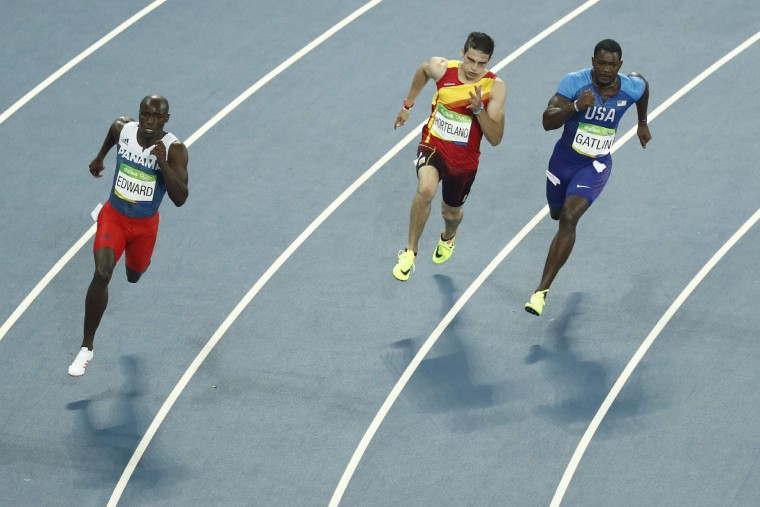 (FromL) Panama's Alonso Edward, Spain's Bruno Hortelano and USA's Justin Gatlin compete in the Men's 200m Semifinal during the athletics event at the Rio 2016 Olympic Games at the Olympic Stadium in Rio de Janeiro on August 17, 2016. (Odd Andersen/AFP/Getty Images)