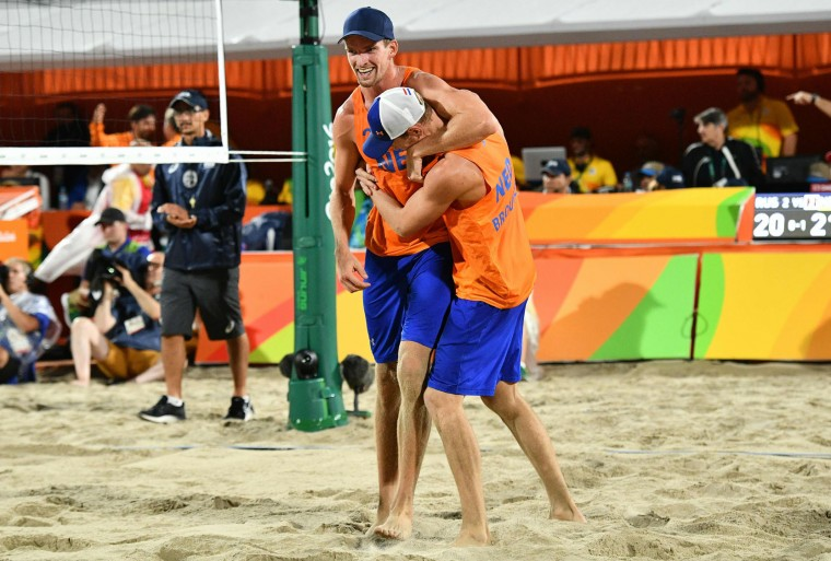 Robert Meeuwsen (L) and Alexander Brouwer of the Netherlands celebrate after winning the men's beach volleyball bronze medal match between Russia and the Netherlands at the Beach Volley Arena in Rio de Janeiro on August 18, 2016, for the Rio 2016 Olympic Games. (Leon Neal/AFP/Getty Images)