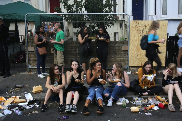 Revellers eat on the second day of the Notting Hill Carnival in west London on August 29, 2016. Nearly one million people are expected by the organizers Sunday and Monday in the streets of west London's Notting Hill to celebrate Caribbean culture at a carnival considered the largest street demonstration in Europe. (Daniel Leal-Olivas/AFP/Getty Images)
