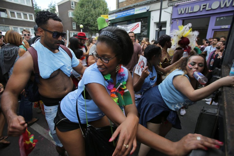 Revellers dance on the second day of the Notting Hill Carnival in west London on August 29, 2016. Nearly one million people are expected by the organizers Sunday and Monday in the streets of west London's Notting Hill to celebrate Caribbean culture at a carnival considered the largest street demonstration in Europe. (Daniel Leal-Olivas/AFP/Getty Images)