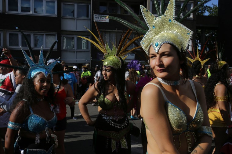 Performers walk on the second day of the Notting Hill Carnival in west London on August 29, 2016. Nearly one million people are expected by the organizers Sunday and Monday in the streets of west London's Notting Hill to celebrate Caribbean culture at a carnival considered the largest street demonstration in Europe. (Daniel Leal-Olivas/AFP/Getty Images)