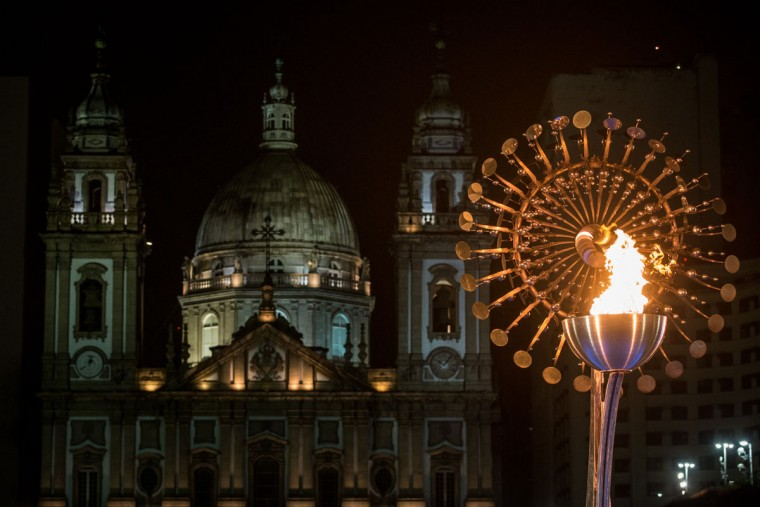 RIO DE JANEIRO, BRAZIL - AUGUST 21: The Olympic flame is seen lit in front of the candelaria church on the Olympic Boulevard while the Rio 2016 closing ceremony takes place at Maracana Stadium on August 21, 2016 in Rio de Janeiro, Brazil. (Photo by Chris McGrath/Getty Images)