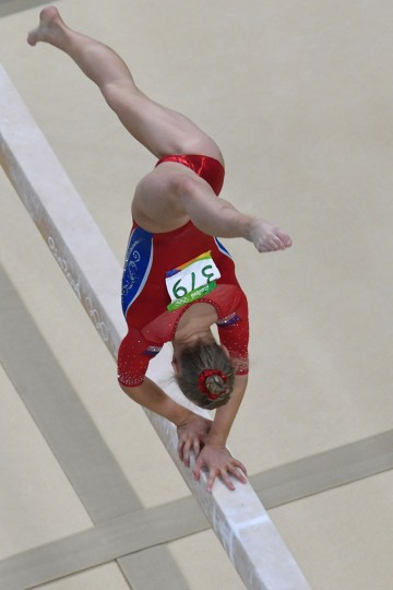 Russia's Angelina Melnikova competes in the Beam event during the women's team final Artistic Gymnastics at the Olympic Arena during the Rio 2016 Olympic Games in Rio de Janeiro on August 9, 2016. (Antonin Thuillier/AFP/Getty Images)