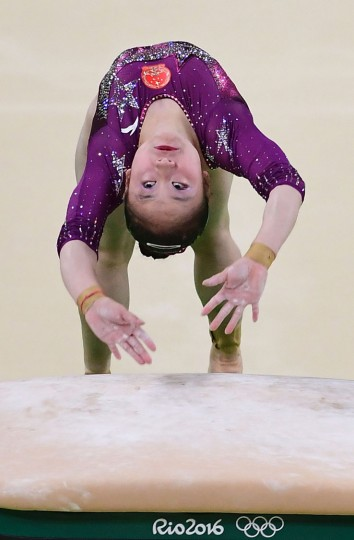 China's Wang Yan competes in the Vault event during the women's team final Artistic Gymnastics at the Olympic Arena during the Rio 2016 Olympic Games in Rio de Janeiro on August 9, 2016. (Emmanuel Dunand/AFP/Getty Images)