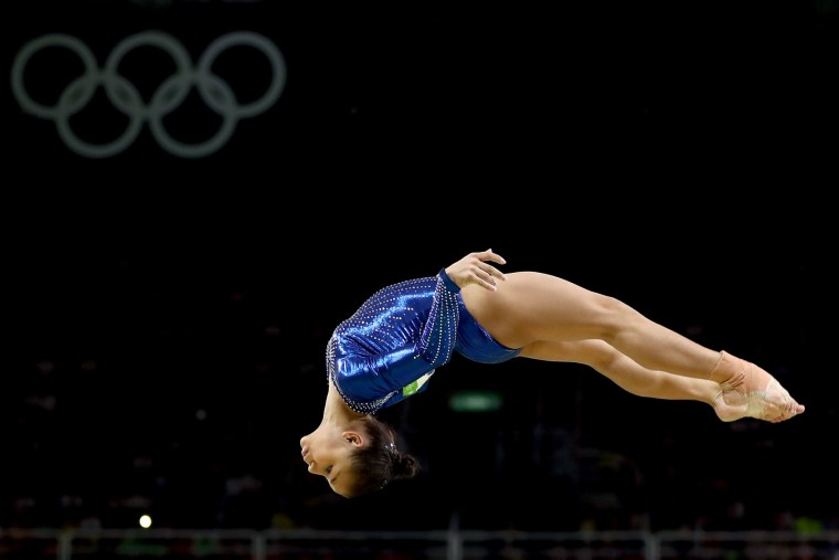 Jade Barbosa of Brazil competes on the balance beam during the Artistic Gymnastics Women's Team Final on Day 4 of the Rio 2016 Olympic Games at the Rio Olympic Arena on August 9, 2016 in Rio de Janeiro, Brazil. (Photo by Lars Baron/Getty Images)