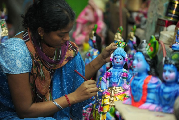 A Indian woman worker gives the finishing touches to an idol of Hindu god Krishna at a workshop in Chennai on August 20, 2016. The birthday of Indian Hindu God Krishna will be celebrated as 'Krishna Janmashtami' by Hindus all over world on August 25. (Arun Sankar/AFP/Getty Images)